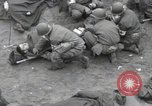 Image of Medics tend to wounded U.S. soldiers on beach Normandy France, 1944, second 23 stock footage video 65675022977