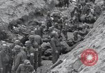Image of Medics tend to wounded U.S. soldiers on beach Normandy France, 1944, second 25 stock footage video 65675022977