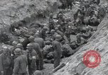 Image of Medics tend to wounded U.S. soldiers on beach Normandy France, 1944, second 27 stock footage video 65675022977