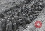 Image of Medics tend to wounded U.S. soldiers on beach Normandy France, 1944, second 28 stock footage video 65675022977