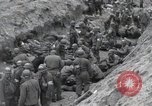 Image of Medics tend to wounded U.S. soldiers on beach Normandy France, 1944, second 29 stock footage video 65675022977