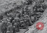 Image of Medics tend to wounded U.S. soldiers on beach Normandy France, 1944, second 30 stock footage video 65675022977