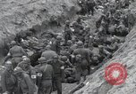 Image of Medics tend to wounded U.S. soldiers on beach Normandy France, 1944, second 31 stock footage video 65675022977