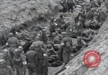 Image of Medics tend to wounded U.S. soldiers on beach Normandy France, 1944, second 32 stock footage video 65675022977