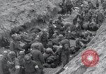 Image of Medics tend to wounded U.S. soldiers on beach Normandy France, 1944, second 34 stock footage video 65675022977