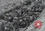 Image of Medics tend to wounded U.S. soldiers on beach Normandy France, 1944, second 35 stock footage video 65675022977