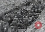 Image of Medics tend to wounded U.S. soldiers on beach Normandy France, 1944, second 37 stock footage video 65675022977