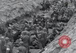 Image of Medics tend to wounded U.S. soldiers on beach Normandy France, 1944, second 38 stock footage video 65675022977