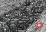 Image of Medics tend to wounded U.S. soldiers on beach Normandy France, 1944, second 40 stock footage video 65675022977