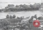 Image of Medics tend to wounded U.S. soldiers on beach Normandy France, 1944, second 41 stock footage video 65675022977