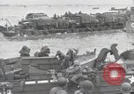 Image of Medics tend to wounded U.S. soldiers on beach Normandy France, 1944, second 43 stock footage video 65675022977