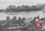 Image of Medics tend to wounded U.S. soldiers on beach Normandy France, 1944, second 44 stock footage video 65675022977