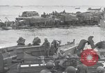 Image of Medics tend to wounded U.S. soldiers on beach Normandy France, 1944, second 45 stock footage video 65675022977