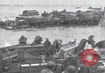 Image of Medics tend to wounded U.S. soldiers on beach Normandy France, 1944, second 46 stock footage video 65675022977