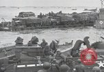 Image of Medics tend to wounded U.S. soldiers on beach Normandy France, 1944, second 47 stock footage video 65675022977