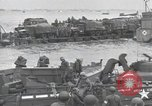 Image of Medics tend to wounded U.S. soldiers on beach Normandy France, 1944, second 48 stock footage video 65675022977