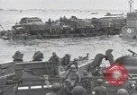 Image of Medics tend to wounded U.S. soldiers on beach Normandy France, 1944, second 49 stock footage video 65675022977