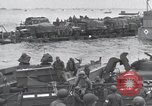 Image of Medics tend to wounded U.S. soldiers on beach Normandy France, 1944, second 50 stock footage video 65675022977