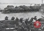 Image of Medics tend to wounded U.S. soldiers on beach Normandy France, 1944, second 51 stock footage video 65675022977