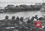 Image of Medics tend to wounded U.S. soldiers on beach Normandy France, 1944, second 52 stock footage video 65675022977