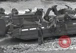 Image of Medics tend to wounded U.S. soldiers on beach Normandy France, 1944, second 53 stock footage video 65675022977