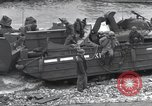 Image of Medics tend to wounded U.S. soldiers on beach Normandy France, 1944, second 54 stock footage video 65675022977