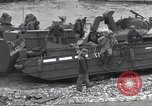 Image of Medics tend to wounded U.S. soldiers on beach Normandy France, 1944, second 55 stock footage video 65675022977