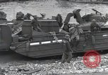 Image of Medics tend to wounded U.S. soldiers on beach Normandy France, 1944, second 56 stock footage video 65675022977