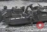 Image of Medics tend to wounded U.S. soldiers on beach Normandy France, 1944, second 57 stock footage video 65675022977