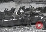 Image of Medics tend to wounded U.S. soldiers on beach Normandy France, 1944, second 59 stock footage video 65675022977