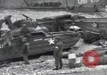 Image of Medics tend to wounded U.S. soldiers on beach Normandy France, 1944, second 61 stock footage video 65675022977