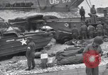 Image of Medics tend to wounded U.S. soldiers on beach Normandy France, 1944, second 62 stock footage video 65675022977
