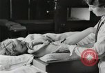 Image of Fever treatment in 1930s United States USA, 1936, second 55 stock footage video 65675023074