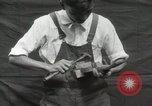 Image of Construction of Ukulele Hawaii USA, 1917, second 17 stock footage video 65675023085