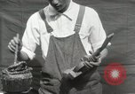 Image of Construction of Ukulele Hawaii USA, 1917, second 23 stock footage video 65675023085