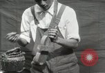 Image of Construction of Ukulele Hawaii USA, 1917, second 24 stock footage video 65675023085