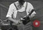 Image of Construction of Ukulele Hawaii USA, 1917, second 26 stock footage video 65675023085