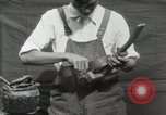Image of Construction of Ukulele Hawaii USA, 1917, second 28 stock footage video 65675023085