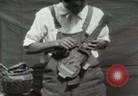 Image of Construction of Ukulele Hawaii USA, 1917, second 29 stock footage video 65675023085