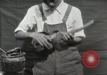 Image of Construction of Ukulele Hawaii USA, 1917, second 31 stock footage video 65675023085