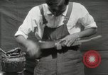 Image of Construction of Ukulele Hawaii USA, 1917, second 37 stock footage video 65675023085