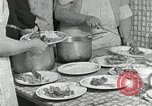Image of Mission workers meal Campbell County Tennessee USA, 1935, second 15 stock footage video 65675023119