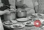 Image of Mission workers meal Campbell County Tennessee USA, 1935, second 16 stock footage video 65675023119