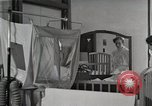 Image of baby in oxygen tent Detroit Michigan USA, 1936, second 4 stock footage video 65675023151
