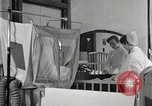 Image of baby in oxygen tent Detroit Michigan USA, 1936, second 5 stock footage video 65675023151