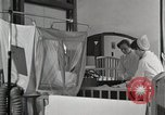 Image of baby in oxygen tent Detroit Michigan USA, 1936, second 13 stock footage video 65675023151