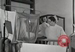 Image of baby in oxygen tent Detroit Michigan USA, 1936, second 15 stock footage video 65675023151
