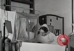 Image of baby in oxygen tent Detroit Michigan USA, 1936, second 17 stock footage video 65675023151