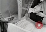 Image of baby in oxygen tent Detroit Michigan USA, 1936, second 34 stock footage video 65675023151