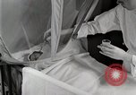 Image of baby in oxygen tent Detroit Michigan USA, 1936, second 35 stock footage video 65675023151